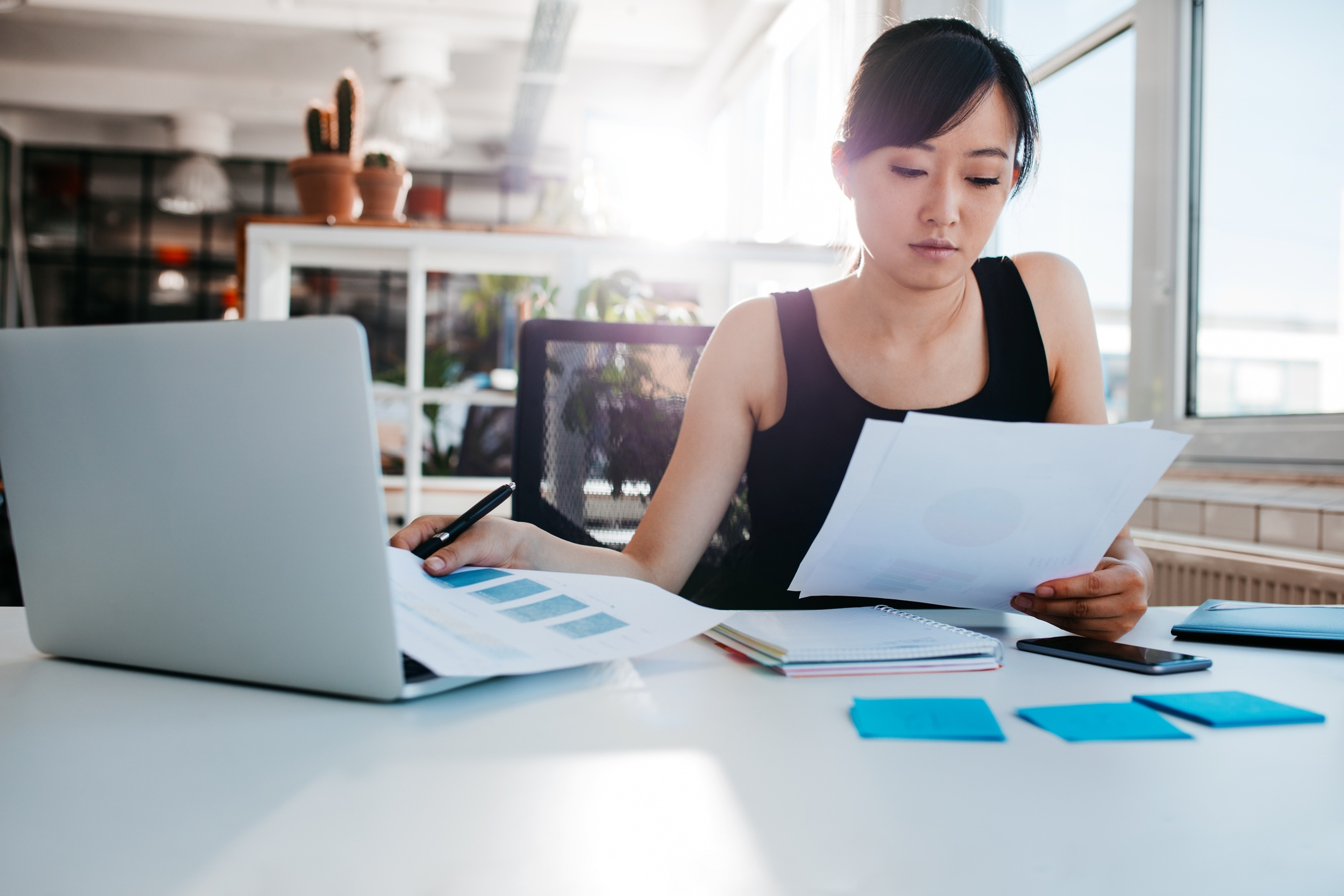 Business woman reviewing documents