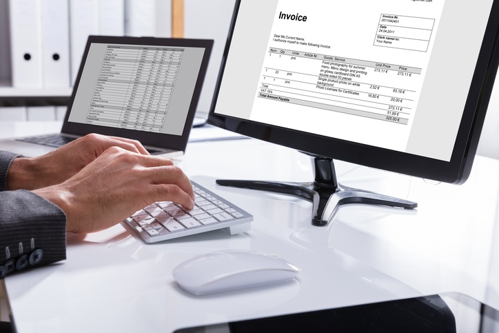 Man-Viewing-Invoice-Digitally-On-Computer